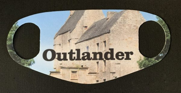 Unique personal Outlander fashion face mask featuring Lallybroch Castle from Outlander